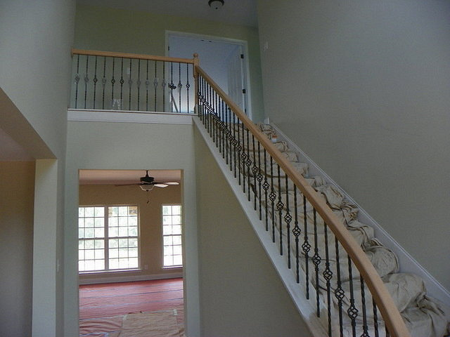 Fluted Staircase with Wrought Iron Railing