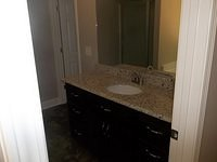 Bathroom Vanity with Custom Cabinets and Granite Counter tops.