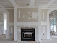 Drywall in keep room with fireplace