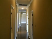 Hallway with hardwood flooring