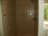 Shower with Custom Tile and Standard Bronze Fixtures